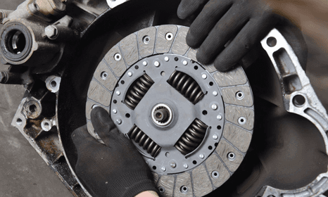 Clutch replacement with hand in black gloves
